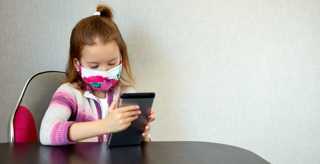 Girl wearing PPE mask