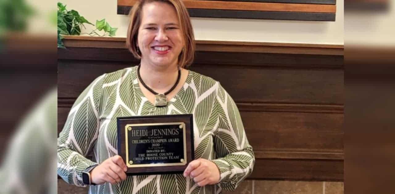 Photo of Heidi Jennings holding award